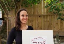 Sonia Gordon-Walinsky holds a pasuk calligraphy piece.