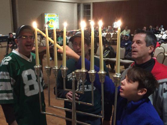 Temple Beth Hillel-Beth El Men's Club light Chanukah candles