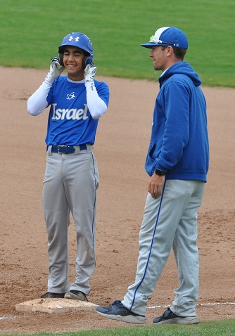 Jake Rosenberg, who plays on the Israeli national baseball team, counsels a highly focused young Israeli player