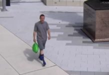 The alleged suspect carries a green bag