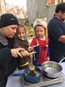 Jewish Farm School participants make candles