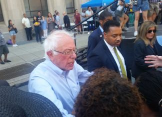 Bernie Sanders shakes hands with attendees at the rally against the Hahnemann closure.