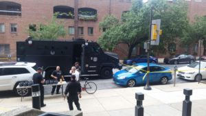 A SWAT van and police tape outside the Jewish Community Services Building