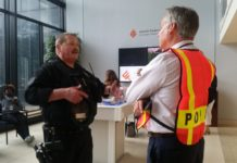 Sgt. William Frazier, left, speaks with Frank Riehl, Jewish Federation director of security