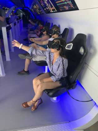Katie Brotz experiences the high-tech virtual reality system at the Peres Center for Peace.