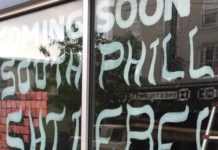A window with Coming Soon South Philly Shtiebel painted on