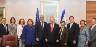 U.S. Rep Ted Deutch next to Israeli Prime Minister Benjamin Netanyahu, in a group of 10 people