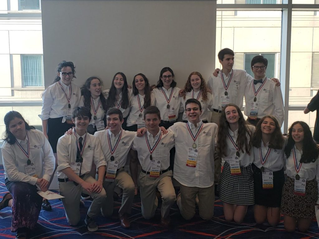A group of Jack M. Barrack Hebrew Academy students with medals around their neck