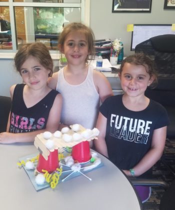 Think Tank science program campers build bridges out of basic materials