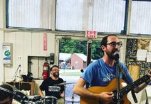 Max Rivel, Rabbi Joel Seltzer and Rabbi Josh Warshawsky play music in a band