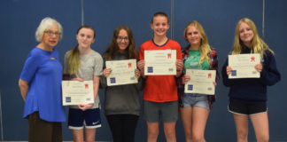 Evelyn Goldhammer, NCJW Holocaust Essay Contest chair, and the winners selected at the Springfield Township Middle School: Natalie Alley, Grace Rebeck, Kalei Noonan, Sophia Glodek and Lizzie McMurray