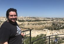 Adam DeSchriver in Jerusalem, Israel with Dome of the Rock visible in background