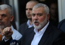 Hamas leader Ismail Haniyeh (right) speaks to the press in the southern Gaza Strip on Sept. 19, 2017.