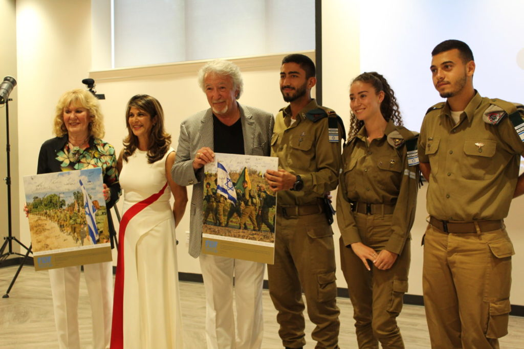 Barbara Brodsky and Israel Roizman are presented with gifts of appreciation for supporting Friends of the Israel Defense Forces