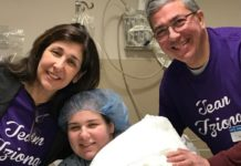 Tziona Zellis sitting in a hospital bed with her parents Sheryl and Davis Zellis
