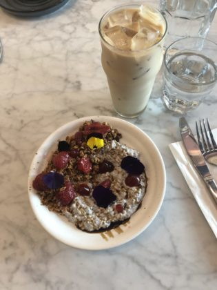 Chia pudding bowl with granola and berries and an iced coffee