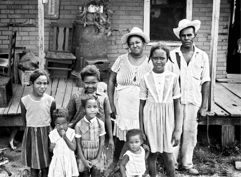 Black and white historic photo of a sharecropping family