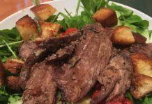 flank steak on a salad