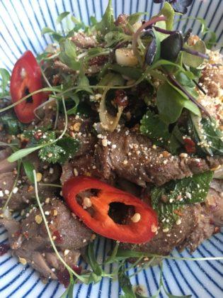 yum nua ma kua poa, or grilled sliced beef salad