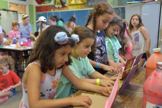 girls do arts and crafts at Camp Kef at the Kaiserman JCC