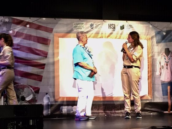 An Ann's Choice resident with an Israel Scout on stage