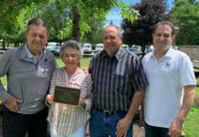 Henry M. Skier, president of AMSkier, who presented the award; Carole Domsky; Sam Domsky; and Andrew Yankowitz, director and owner of Tall Pines Day Camp