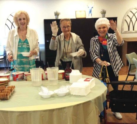 Three elderly women with bowls of ice cream