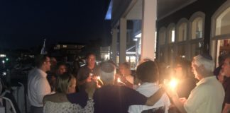 Har Zion Temple members gather in a circle around a Havdallah candle