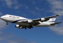 an el al airplane flies through air