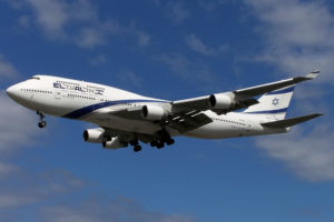 an el al airplane flies through air