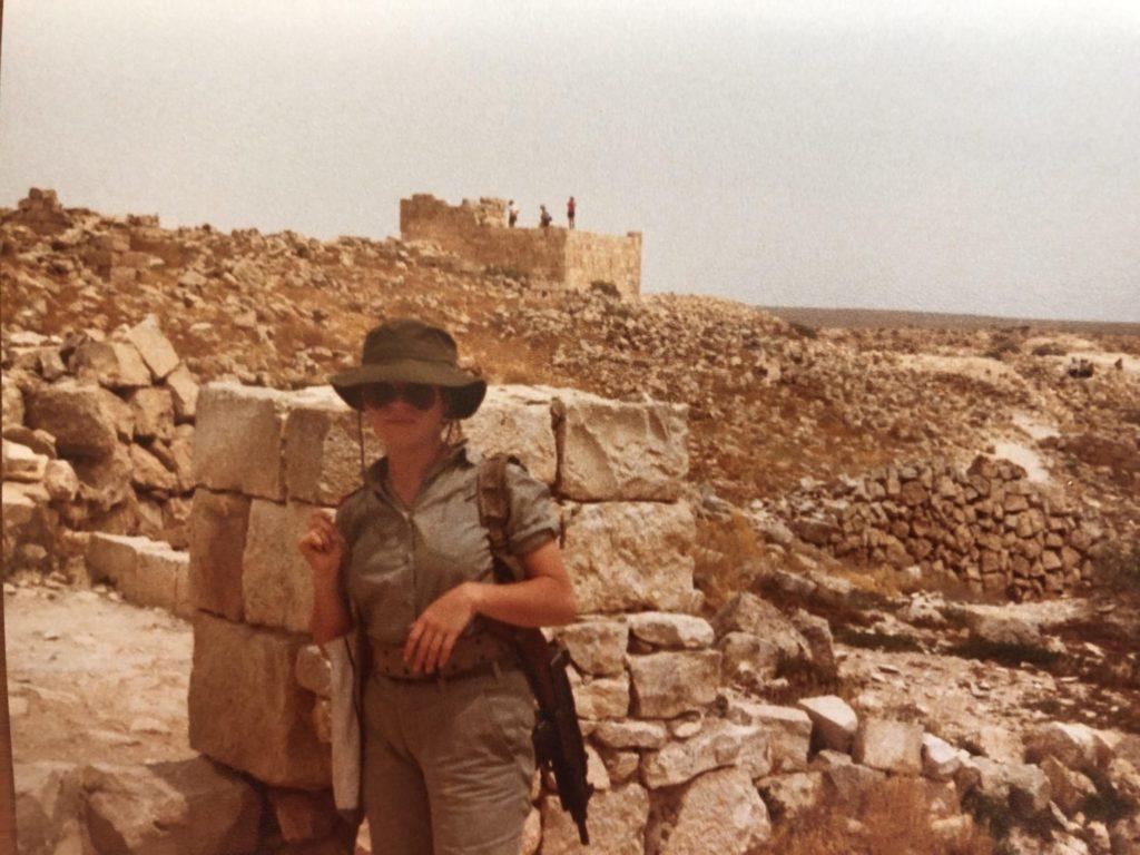 Ayala Laufer-Cahana in an IDF uniform with a gun