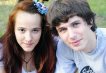 a girl with red hair and a boy with brown hair