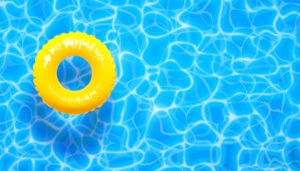 yellow pool float ring in a pool