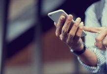 a man holds a smart phone