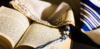 a tallit and siddur