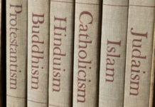 book spines with different religions on them