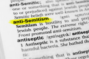 the word anti-semitism highlighted in a dictionary