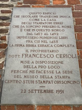 Plaque in Italian outside museum building at 8 Via Lanfranco