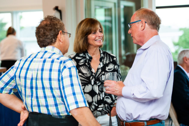 Board member Tracey Specter chats with fellow attendees.