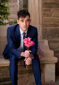 Daniel Irwin holds roses