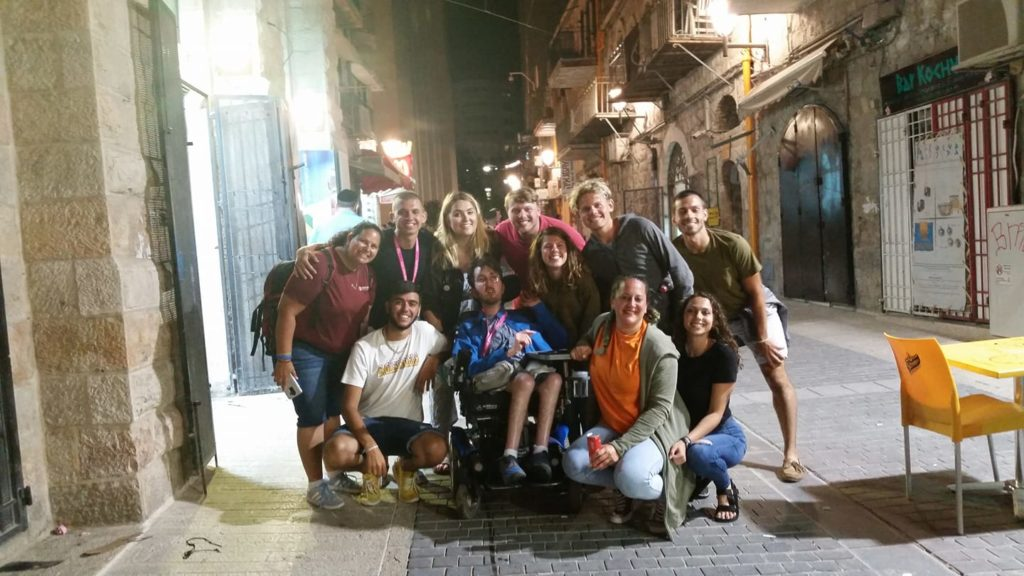 Alex Van Hook in a wheelchair with other ASL Birthright attendees in Jerusalem