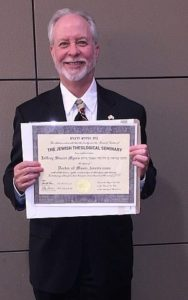 Rabbi Hazzan Jeffrey Myers holds a diploma