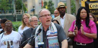 Rabbi Shawn Zevit speaks at the anti-gun violence rally.