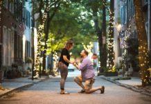 Drew Seid proposes to Rachel Waxman on a street with fairy lights