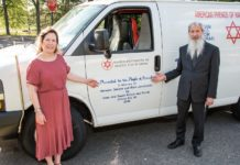 Susan and Evan Krisch in front of a Magen David Adom ambulance