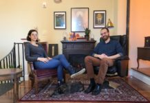 Maëlle Doliveux and Josh O'Neill sit on chairs in a cozy looking room