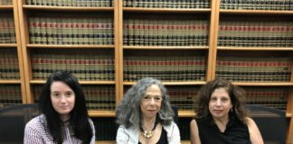 Rebecca Richman, Susan Wolfson and Ronda Goldfein, the women behind Safehouse, sit in a conference room