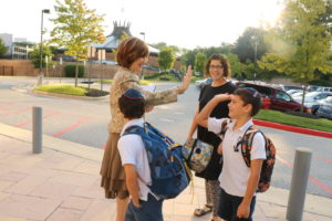 Zipora Schorr greets students