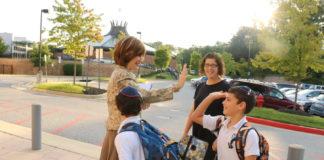 Zipora Schorr greets students