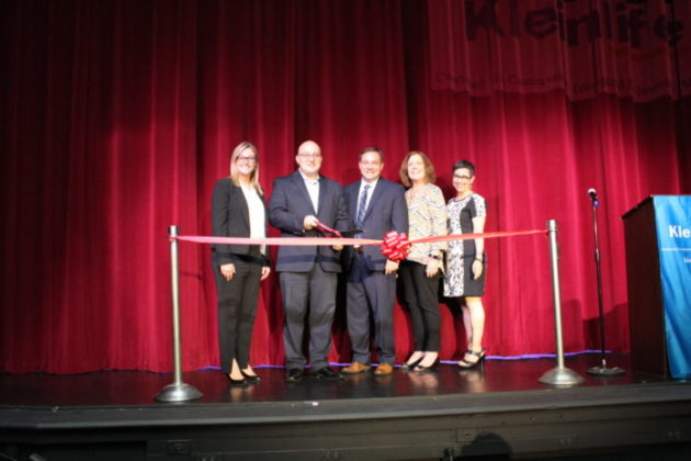 a group of officials at a ribbon cutting for Kleinlife's theater